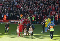 Liverpool's Steven Gerrard applauds the Anfield crowd as he is greeted by a guard of honour before the Barclays Premier League match at Anfield