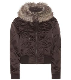 Yeezy - Faux fur-trimmed jacket (Season 1) - Cropped at the waist for a contemporary and feminine fit, this padded jacket from YEEZY is a street style staple for fall and winter. A classic black body comes with a light satiny shine for a luxe finish, while the faux fur-trimmed hood is both tactile and warm. Wear yours with sneakers and track pants for an urban look. seen @ www.mytheresa.com