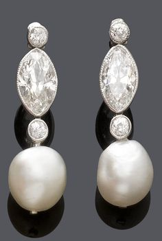 A PAIR OF BELLE EPOQUE PEARL AND DIAMOND EAR PENDANTS, CIRCA 1910. Each set with…