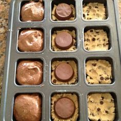 preheat oven to 350; smoosh 1.5 squares of break-apart refrigerated cookie dough into the bottom of each well.  place reese cup upside down on top of cookie dough (or an oreo!).  top with prepared box brownie mix, filling 3/4 full.  bake for 18 minutes