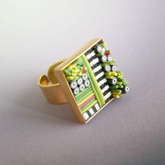 Adjustable Brass Ring Mosaic Polymer in greens, yellows and pinks. $74.00, via Etsy.
