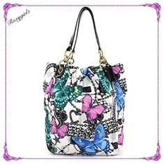 """COACH PARKER BUTTERFLY TOTE #13415 ~ RARE ~ NWTC! RARE~ COACH PARKER BUTTERFLY TOTE #13415 CARRIED 4-5 TIMES LIKE NEW! NO MARKS OR STAINS Gorgeous vibrant exterior colors with Butterfly, Hearts, Stars & Coach Charm & Bead Design Water & Stain Resistant Nylon Fabric Patent leather trim & brass grommets Lavender fabric lining Large inside zip & 2 slip pockets Dog leash closure Key Clip Measures Approx: 9"""" Strap Drop 10.5"""" L X 15"""" H X 8.5"""" W INCLUDES DUST BAG ❌NO TRADE❌ Coach Bags Totes"""