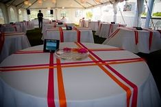 simply pretty wedding: Bright table decor - I dig the ribbon criss-cross, although I have no idea how long it would take to do. Banquet Centerpieces, Banquet Decorations, Banquet Tables, Banquet Ideas, Basketball Decorations, Communion Decorations, Ribbon Decorations, Basketball Party, Simple Centerpieces