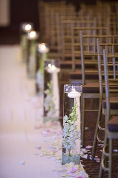 Cylinder vases in varied heights with submerged purple tulips, lavender spray roses and picasso calla lilies line the aisle. Wedding Ceremony Ideas, Wedding Aisle Candles, Floating Candles Wedding, Wedding Aisle Decorations, Wedding Centerpieces, Wedding Photos, Wedding Aisles, Wedding Backdrops, Bridal Pictures