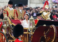 Their Royal Highnesses Prince William, Duke of Cambridge and Catherine, Duchess of Cambridge journey by carriage procession to Buckingham Palace following their marriage at Westminster Abbey on April 29, 2011 in London, England. The marriage of the second in line to the British throne is to be led by the Archbishop of Canterbury and will be attended by 1900 guests, including foreign Royal family members and heads of state. Thousands of well-wishers from around the world have also flocked to…