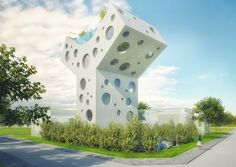 offering a respite from city life, the distinctive residence is characterized by its feng shui design and the large, circular windows that puncture its concrete façade.