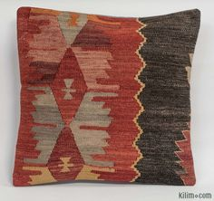 Decorative hand woven pillow cover made of 40-50 years old Turkish kilim fragments backed with cotton cloth. Zipper closure. Insert not included.