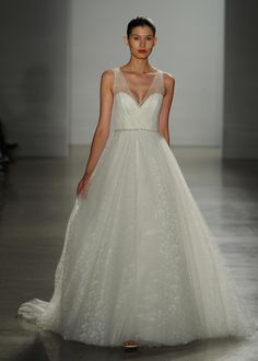 Christos Fall 2016 floral textured tulle ball gown wedding dress with hand beaded crystal belt | https://www.theknot.com/content/christos-wedding-dresses-bridal-fashion-week-fall-2016