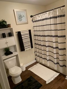 Black and white bathroom decor with a touch of yellow and green. (Not visible in photo) Black Bathroom Decor, Boho Bathroom, Bathroom Interior, Black White Bathrooms, Small Bathroom, Master Bathroom, Black And White Bathroom Ideas, First Apartment Decorating, Apartment Ideas