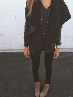Black on black | black shearling and suede drape waterfall jacket | silky flowy black top / shirt | black leggings / skinny jeans | tan suede ankle boots