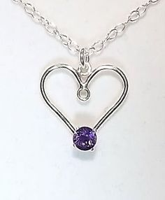 Amethyst Pendant. A Sterling Silver Heart handset with 4mm Amethyst.