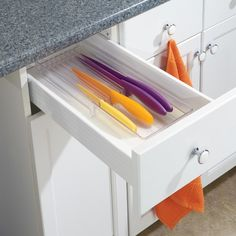 Keep your kitchen knives neat and tidy with an simple and functional InterDesign Linus Drawer Knife Organizer.