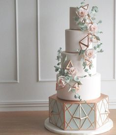 C A K E P E R F E C T I O N ... Love the soft mint tones paired with a contrasting copper geometric accent. Perfection! : @aelizabethcakes