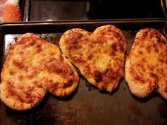 Heart shaped pizza's Need:  98¢ pizza dough mix from store, ragu pizza sauce, toppings desired Mix dough according to pkg Lay dough out (my pkg made 3 individual pizza's) shape into heart shape  Spread sauce on pizza dough  Add desired toppings and bake @ 400° for 12 min