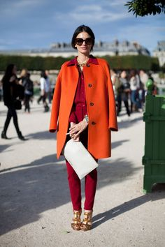 STREET STYLE SPRING 2013: PARIS FASHION WEEK - Red and orange make for the unofficial shades of autumn.