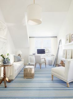 White and blue living room with office area designed by Victoria Hagan Interiors. Photo by Pieter Estersohn (via House of Turquoise).