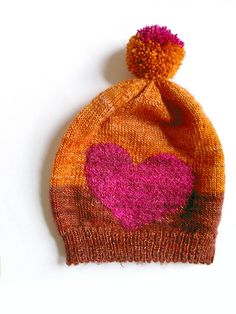 Xol is a color block beanie with a large intarsia motif: charts for a large heart or a flower are included and if you want something else, a blank chart is also included to make your own motif.