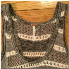 NWOT Racerback Knit Slvless racerback knit. Tags are missing, but top never worn. Cotton/Acrylic/Poly Free People Tops