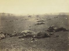 "This photo, known as ""A Harvest of Death,"" comes from Alexander Gardner's Photographic Sketchbook of the War. On July 5, 1863, two days after the battle ended, Gardner and his assistants were the first photographers to arrive on the scene. He identified the dead men as Rebels, but later analysis revealed they were Federals whose shoes had been taken.  These artifacts are a part of Smithsonian Books' fall release Smithsonian Civil War: Inside the National Collection"