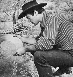 Clint pans for precious gold ore, washing the sand carefully to remove . Clint Walker Actor, Cheyenne Bodie, James Drury, Western Art, American Actors, In Hollywood, Gorgeous Men, Golden Age, Firearms