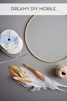 Gold-dipped feathers are the center piece of this dreamy dream catcher mobile.