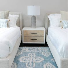 A pair of  linen upholstered beds create a  modern coastal vibe in this fun and cozy guest room!  beds: @fourhandsfurniture  nightstand: @universalfurniture  pillows: @fabricut  @lacefielddesigns_  rug: @suryasocial  linens: @matouklinens