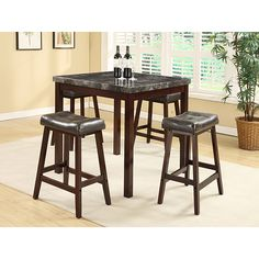 This dining set features a clean and simple design for your dining area. The set includes the table and four chairs in a espresso finish.