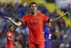 Sergio Busquets of Barcelona reacts during the La Liga match between Levante UD and FC Barcelona at Ciutat de Valencia on September 21, 2014 in Valencia, Spain.