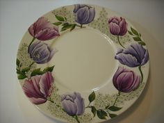 Hand-painted porcelain.  Love the tulips and the colors.