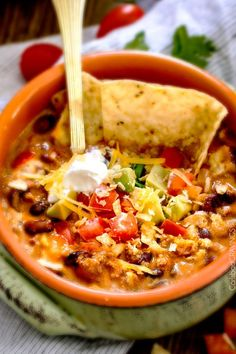 30 minute BEST EVER One Pot Cheesy Taco Soup is the ultimate comforting soup packed with all your favorite taco flavors and is SO easy and great for crowds!