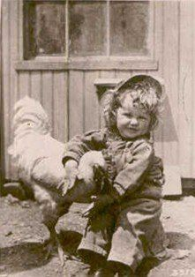 Vintage photo of a young child hugging her chicken - I had a favorite chicken when I was growing up too