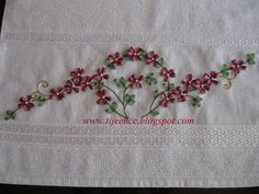 Ribbon Embroidery - This page has four different picture tutorials using organza ribbon: poinsettia, five petal flowers, heartsease, and daisies (shown in picture).