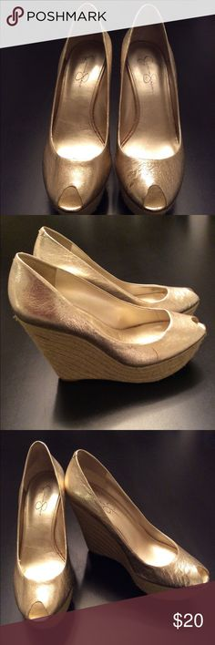 Jessica Simpson, Gold/Metallic Peep Toe Wedge Comfortable Wedge. I can walk in these all day at work and feel good.  True to size. They have a small blemish on the right shoe that was there when I purchased. It is shown in pic.  Good condition Jessica Simpson Shoes Wedges
