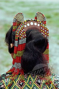 Philippines | Close up of the head dress of comb and beads of a woman of T'boli woman.  Southern Mindanao | ©Robert Harding
