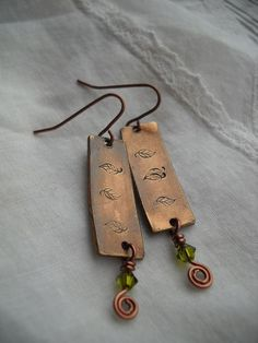 Hand stamped leaves on copper and wire wrapped by RisingDawnBoutique