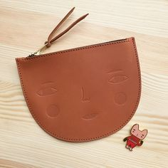 """New Donna Wilson 100% leather zip pouch with Donna's """"Little Helper"""" brooch."""