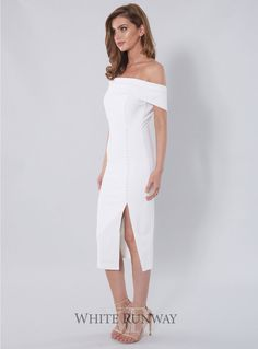 Eva Dress. A chic off-the-shoulder cocktail dress by Giselle & Sophia. Available in all-ivory or black and white (multi). Very comfortable to wear with a stretch in the material and front leg slit.