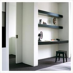 GAP Interiors - Table fan and book on built in desk in bedroom - Picture library specialising in Interiors, Lifestyle & Homes