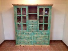 "Display your collectibles in the beautiful Shaker Hutch.  Hand crafted from pine with glass panel doors and 13 drawers for storage.  Measures 96"" tall, 64"" long, 20"" deep. Saddleblanket Home Collection cabinets, servers, book cases, and armories are hand crafted from the finest materials.  Under the watchful eye of our own artisans, each piece receives meticulous attention to detail and reflects our dedication to providing quality Western, Southwest, Adobe, Santa Fe, ranch, lodge, and rustic…"