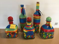 Liquor bottles hand painted in M&M colors and filled with M&M candy. Mexican blanket theme.
