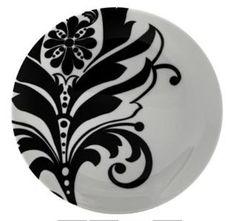 Prato decorativo de porcelana com 19cm de diâmetro. Acompanha suporte para fixação na parede.