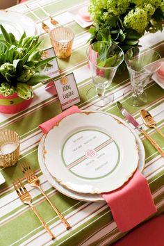 Vintage china paired with green striped linens and coral napkins for the perfect garden event