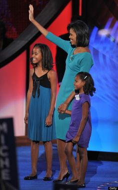 Michelle Obama & daughters Malia & Sasha .