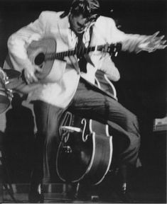 "Elvis performing during second show in the fieldhouse - May 27, 1956 Photo by Marvin Israel © Lawrence Israel courtesy ""Elvis Presley 1956"""