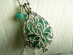 Worry Locket  green jade gemstones in teardrop locket by GhostShip