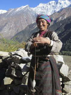 Tsum Valley, Nepal. Woman using a traditional spinning technique. I'd love to learn.