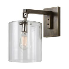 Parrish Wall Sconce features a Clear glass cylinder with an Antique Bronze finish. One 40 watt, 120 volt Edison A-Shape type Medium base incandescent bulb is required, but not included. 8 inch width x 15 inch height x 9 inch depth. UL Listed.  Damp Rated.