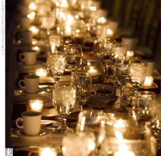 The site overlooked the glowing lights of Tucson and the mountains. Two long tables were decorated with ivory linens, chocolate-brown satin runners, and dozens of square ivory candles. To add to the ambience, strings of white lights were wound around curl...