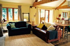 self-catering barn sleeping 4 overlooking the Black Mountains, set in 48 acres of hillside and woodland, Garn Farm provides the perfect escape. Living Area, Cosy, Duvet, Barn, Bedroom, Furniture, Home Decor, Down Comforter, Converted Barn