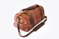 The last duffle bag you'll ever need to buy. 100% Vegetable Tanned Leather is supple but tougher than nails. Tuxedos need not apply.